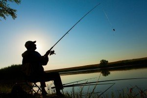 Old- Man - fishing -in -lake -in evening